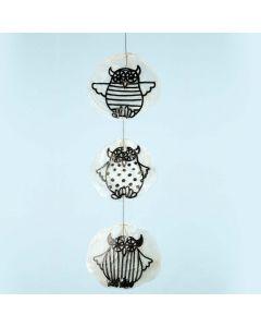 Pöllöillä koristellut simpukat