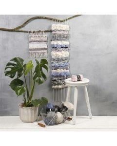 Pitkä tekstiilikoriste eri materiaaleista