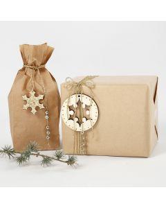 Lahjapaketit kultaisilla koristeilla