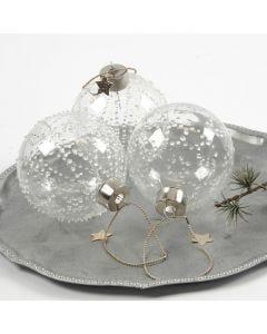 Lasipallo, jonka koristeet on tehty läpinäkyvällä liimalla.