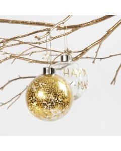 Kultaisilla tähdillä koristeltu lasipallo