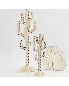 Polttokolvilla koristellut kaktus ja lehti
