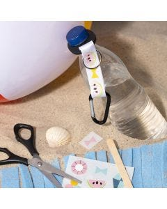 Siirtotarroilla koristeltu pullon pidike