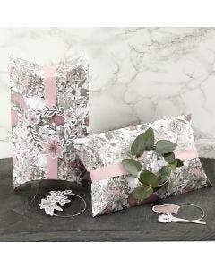 Vaaleanpunaisella nauhalla, metallirenkaalla ja kukkakuvioilla koristeltu lahjarasia