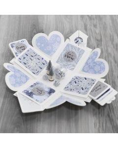 Kuviopaperilla ja talvisilla koristeilla koristeltu avattava rasia