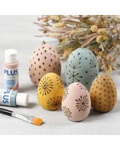 Polttokolvilla koristellut puiset munat