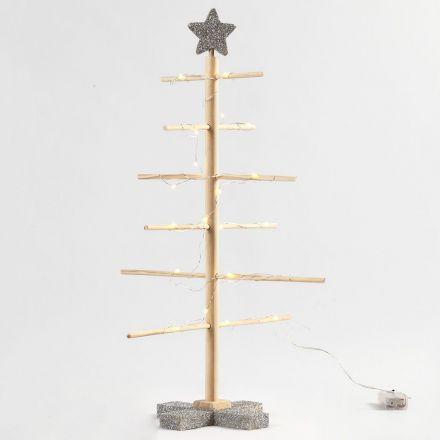Itsekoottava joulukuusi ja hopeista glitteriä