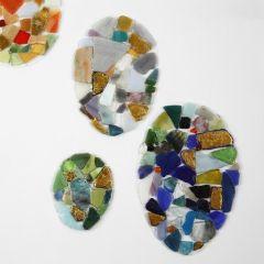 Mosaiikilla koristellut voimakalvomunat