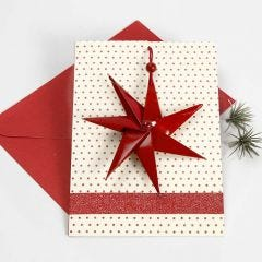 Joulukortti, jossa seitsensakarainen tähti