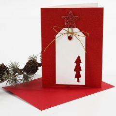 Kimallekorttipohja, jossa pakettietiketti ja koristeellinen paperiliitin