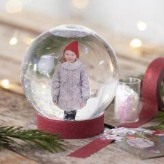 Lumisadepallo kuvalla