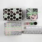 Design Lahjapaketointia käyttäen koristeita ja Vivi Gade-paperia