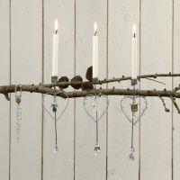 Kynttilät oksalla
