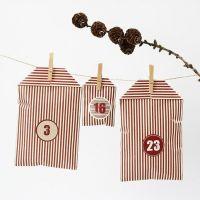 Joulukalenteri raidallisista Vivi Gade design- paperipusseista