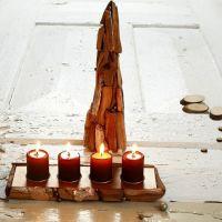 Puun lämpöä ja kuparin hohtoa kynttelikössä