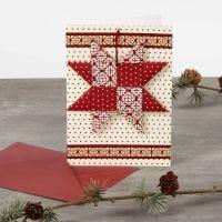 Punottu tähti joulukortissa