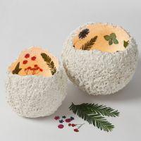 Kuivakukilla koristellut paperimassalyhdyt