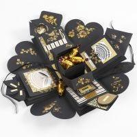 Räjähtävä rasia, jossa lahjana rahaa ja suklaata